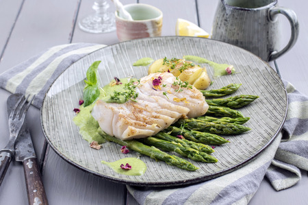 fish fillet: fish fillet with green asparagus Stock Photo