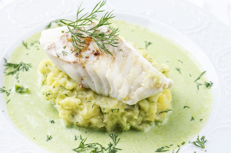 peeled off: Cod filet in Basil Champagne Foam Stock Photo