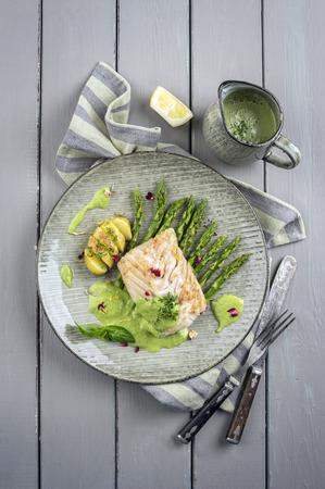 delikatesse: coalfish fillet with green asparagus