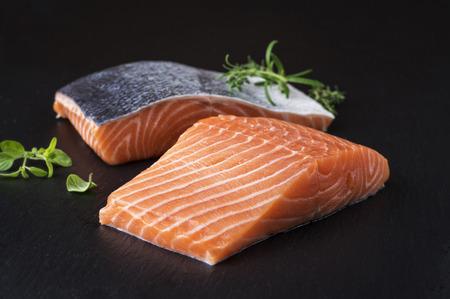 salmon filet: Salmon filet on a black slab of slate