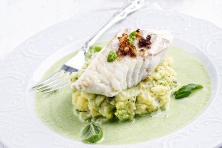 coalfish: Cod filet in Basil Champagne Foam Stock Photo