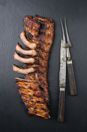 barbecue: Spare Ribs on Black Background Stock Photo