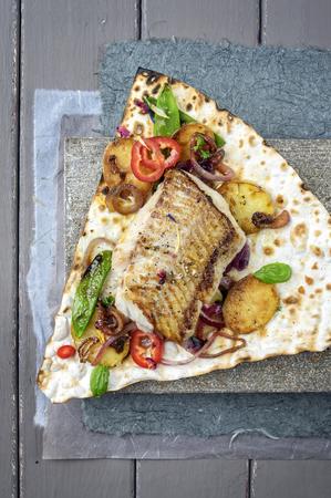 codfish: Codfish Filet with Vegetable on Yufka Bread Stock Photo