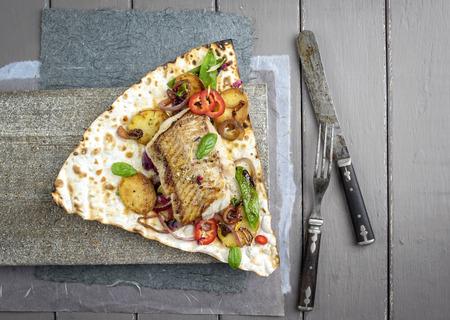 yufka: Codfish Filet with Vegetable on Yufka Bread Stock Photo