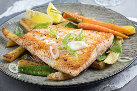 blue fish: Salmon Filet with Vegetable Stock Photo