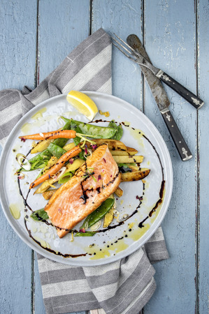 Salmon Filet with Vegetable Stock Photo