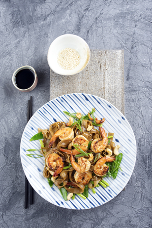 delikatesse: Kingprawns with Rice Noodles and Vegetable on Plate