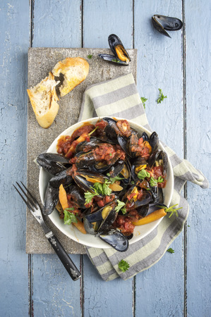 en: Mejillones en Salsa de Tomate Stock Photo