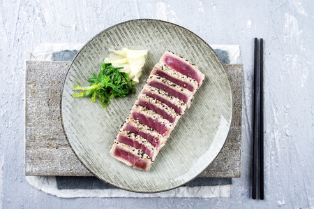 japanese background: Tuna Tataki with Wakame and Ginger