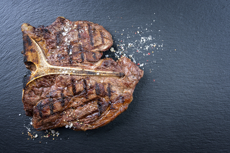 new york strip: Dry Aged Barbecue Porterhouse Steak Stock Photo