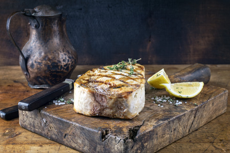 blue fish: Barbecue Swordfish Steak on Chopping Board Stock Photo