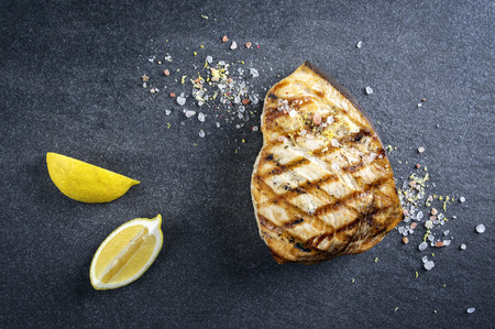black fish: Barbecue Swordfish Steak on Stone Board