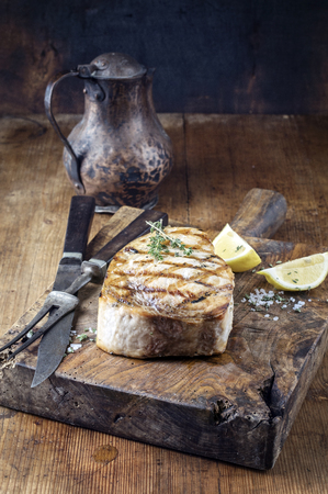 fine fish: Barbecue Swardfish Steak on Cutting Board Stock Photo