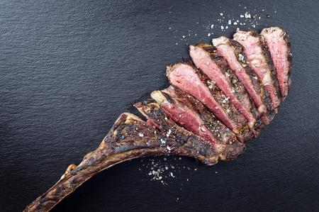 Secco Di età compresa tra bistecca barbecue Tomahawk Archivio Fotografico