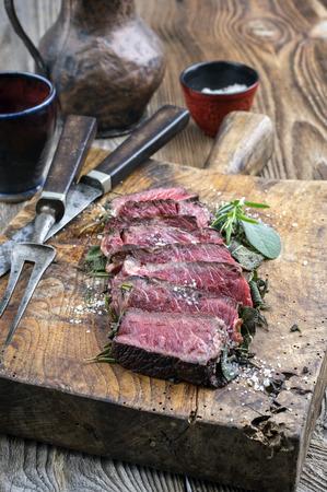 rare background: Dry Aged Barbecue Tagliata