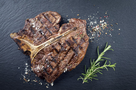 grilled steak: Dry Aged Barbecue Porterhouse Steak Stock Photo