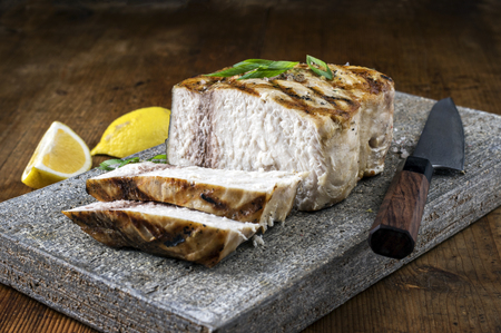 fine fish: Barbecue Swordfish on Flagstone Stock Photo