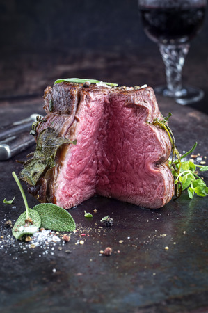 Sirloin steak on old sheet Stock fotó