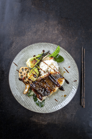 asian style: Coalfish with Vegetable and Rice on Plate Stock Photo