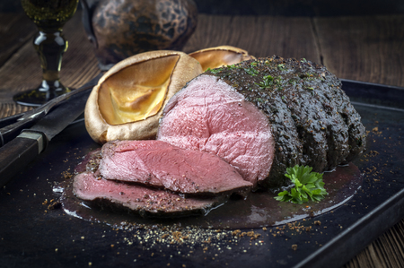 prime rib: Roast Venison with Yorkshire Pudding Stock Photo