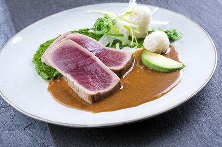 マグロのたたきと野菜の唐辛子クリーム 写真素材