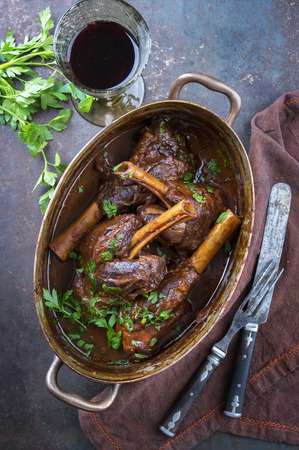 Slow Cooked Lamb Shanks in Red Wine Sauce Stock Photo - 60985556