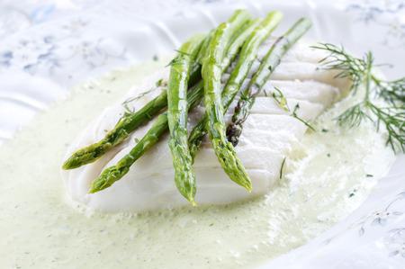codfish: Codfish with Green Asparagus Stock Photo