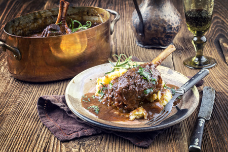 Slow Cooked Lamb Shanks in Red Wine Sauce Stock Photo - 60986404