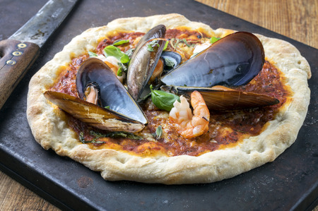 metal sheet: Seafood Pizza on Metal Sheet