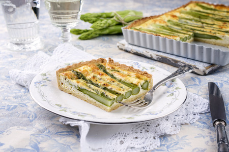 white backing: Tart with Green Asparagus Stock Photo