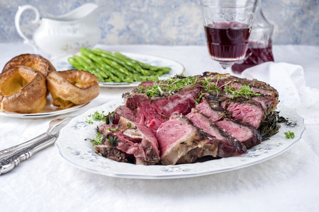 Porterhouse Steak with Yorkshires and Green Asparagus Stock Photo