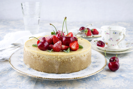 gold table cloth: Cheesecake with Fruits Stock Photo