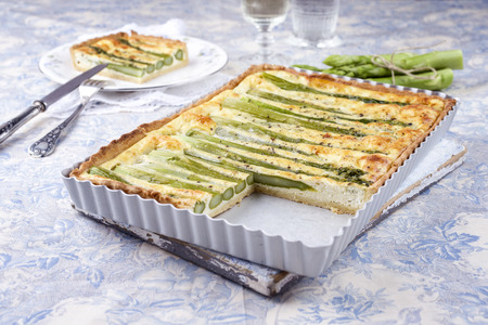 gold table cloth: Tart with Green Asparagus Stock Photo