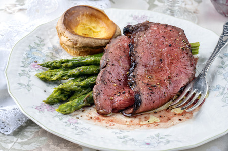 prime rib: Roastbeef with green Asparagus and Yorkshire Pudding Stock Photo