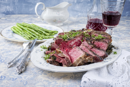 porterhouse: Sliced Porterhouse Steak with Green Asparagus on Plate