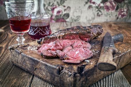 Wagyu entrecote steak on old cutting board Stock Photo