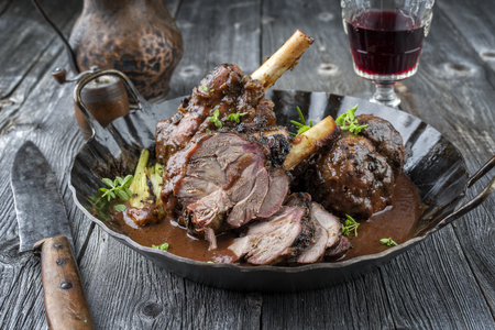 Lamb Knuckles with Vegetables in Red Wine Sauce Stock Photo
