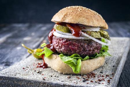 semmel: Barbecue Hamburger with Salad Leaf and Ketchup Stock Photo