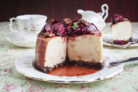 te: Cheesecake with Plum and Pecan Nut on Plate Stock Photo