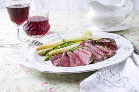 Point Steak with Green Asparagus Stock Photo