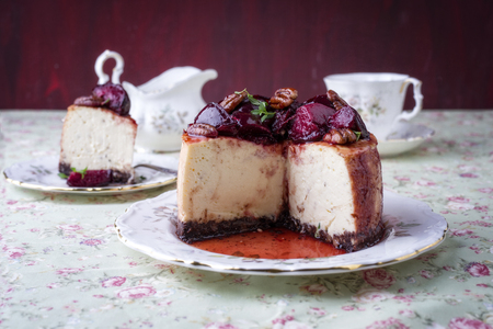 cream cheese: Cheesecake with Plum and Pecan Nut on Plate Stock Photo