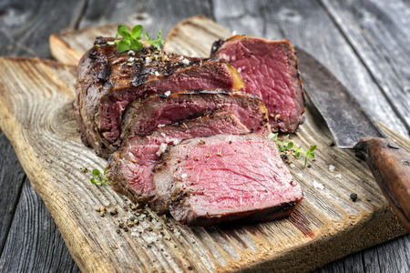 Barbecue Point Steak on old cutting board Stock Photo