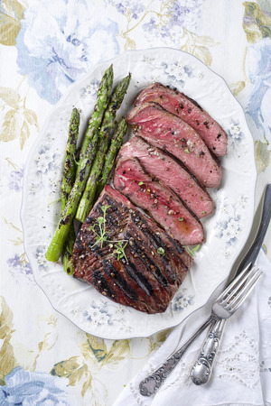 rust red: Barbecue Point Steak with Green Asparagus on Plate Stock Photo