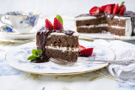 gold table cloth: Choco Nuts Cake with Strawberries on Plate