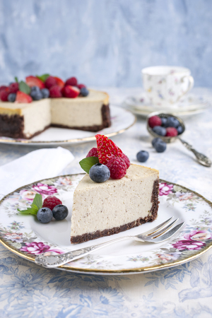 New York Cheesecake with Fruits Stock Photo