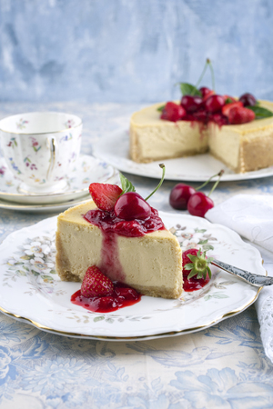 glass topped: CheeseCake with Fresh Fruits Stock Photo