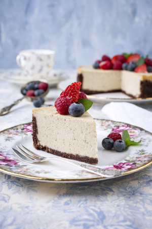 gold table cloth: New York Cheesecake with Fruits Stock Photo