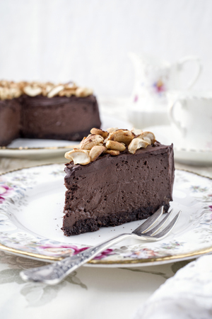Chocolate Pie with Nuts on Plate Stock Photo