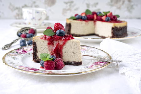 coffee and cake: New York Cheesecake with Fruits Stock Photo