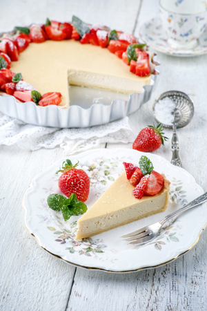 gold table cloth: Cheese Cake with Strawberries